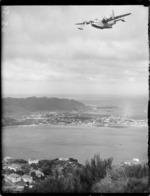 TEAL Solent flying boat Ararangi over Evans Bay