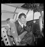 Schoolboy sitting in captain's seat aboard Tasman Empire Airways Ltd Solent Awatere