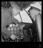 School boy talking to a pilot aboard the TEAL Solent flying boat Awatere