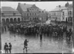 Crowd around a New Zealand regimental band playing in Le Quesnoy, the day after its capture