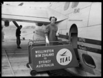 Air hostess Miss J Stanich by the TEAL Solent flying boat Awatere, Evans Bay, Wellington
