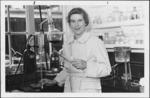 Dr Greta Barbara Stevenson in a laboratory, location unidentified