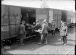 A stretcher case loaded on to a hospital train, France