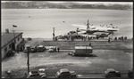TEAL air terminal with Solent flying boat in pontoon dock, Evans Bay