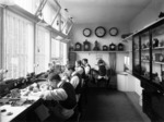 Five men working in a clock and watch making workshop