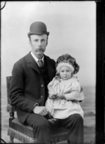 Studio portrait of photographer William Williams holding small child on his knee [Owen William Williams?]
