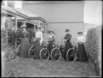 Unidentified women, with bicycles in a garden, probably Christchurch district