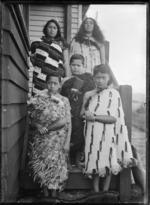 Ripeka Love with her children, alongside their house at Korokoro, Wellington