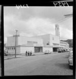 Horticultural Hall and Town Hall, Lower Hutt, Wellington Region, including parked cars and unidentified workers [from Wilkins & Davies?] on Laings Street