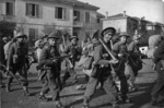 Soldiers of the Maori Battalion moving into line in the Faenza sector, Italy, during World War II