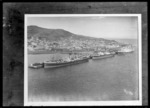 Bluff, Southland, showing three steamships docked at wharves