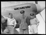 Portrait of [Flight Lieutenant?] Stan Quilt, Squadron Leader Fitzgerald (DFC) and [Group Captain?] Hutcheson (DFC ) of 14th Squadron in front of the 'Parkyakarkus' P-40 Kittyhawk fighter torpedo aeroplane, Whenuapai Airfield, Auckland