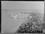 Crowds at Mechanics Bay, Auckland, for the arrival of Pan American Airways [survey?] Clipper, from Samoa