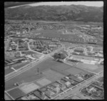 The suburb of Naenae with Walter Mildenhall Park and Naenae Olympic Pool, Naenae Railway Station with Naenae College beyond, Lower Hutt, Wellington Region