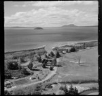 View of the settlement of Oruatua and the Tauranga Taupo River with State Highway 1 to Motutaiko Island beyond, on eastern side of Lake Taupo