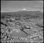 View over the New Plymouth City suburb of Lynmouth with West End and Saint Joseph's Primary Schools to Taranaki Base Hospital, with farmland and Mount Taranaki beyond