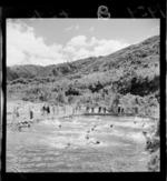 Boys swimming in dammed river, at Boys' Brigade camp, [Rimutaka Forest Park?] Wainuiomata, Lower Hutt