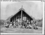 Maori group in front of Tamatekapua meeting house in Ohinemutu - Photograph taken by Frank Arnold Coxhead
