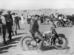 Wellington Photographic Works :Percy Coleman on Royal Enfield motorcycle at Waikanae Beach