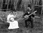Lydia and William Williams with their banjos, Carlyle Street, Napier