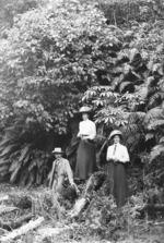 Frank and Amy Hutchinson, with Jerome Spencer, alongside some native bush