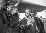 Charles Edward Kingsford Smith, and others, upon the arrival of the aeroplane Southern Cross at Wigram, Christchurch