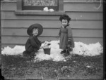 Edgar Williams with unidentified child playing in snow at the Williams' home, Kew, Dunedin
