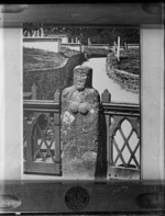 Copy of a photograph by W B & Sons of a [Celtic or Nun?] stone female effigy by a fence in an [English?] cemetery location, taken during Williams' European trip