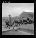 001389: Mrs K Skwaiko leads a group of children to a dining room at a Polish refugee camp, Pahiatua