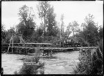 Railway locomotive with logs, on a bridge over the Arnold River, at Kokiri