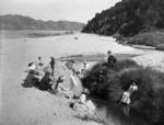 Family group at Broad's Bay, Totaranui