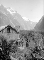 Members of the Gifford party outside a hut