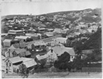 Looking over Maclaggan Street, Dunedin, with Rattray Street in the foreground