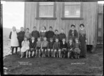 Pupils and staff at Te Uku Public School, 1910 - Photograph taken by Gilmour Brothers