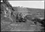 Mail coach on the road between Ngaruawahia and Raglan, near Raglan, 1910 - Photograph taken by Gilmour Brothers