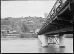 View of Durie Hill with part of the bridge which crosses the Wanganui River, leading from Durie Hill to Victoria Avenue