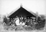 Maori group outside a meeting house at Waipahihi, includes Rangitahau and Kiriwera