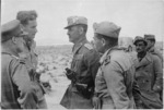 Italian officers General Mannerini and Colonel de Matera after their surrender during World War 2, talking with New Zealanders, Tunisia - Photograph taken by Harold Paton