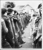 Demonstrators facing a row of police officers - Photograph taken by Ian Mackley