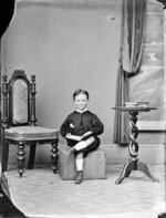Unidentified boy, posed with a book