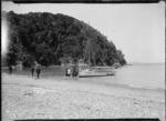 Men boarding a yacht, Cowes Bay, Waiheke Island