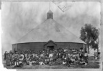 Maori group outside the round meeting house at Mohaka