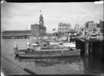 View of Auckland Ferry Building and launches at Freemans Bay