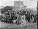 Mayor of Wanganui, Mr Hope Gibbons, placing soil from the battlefields of Belgium in the Maori Memorial - Photograph taken by Frank J Denton