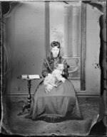 Unidentified woman with dog