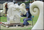 Marie Moanaroa-Parata-Munroe working on a sculpture in Frank Kitts Park, Wellington - Photograph taken by Ray Pigney