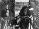 Maori girls playing a string game