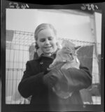 Annabel Norrie holding a cat at the Wellington Cat show