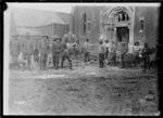 New Zealand Pioneers filling in a mine crater outside a church in Beauvois, World War I