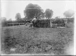 A fall in an army horse jumping event, France